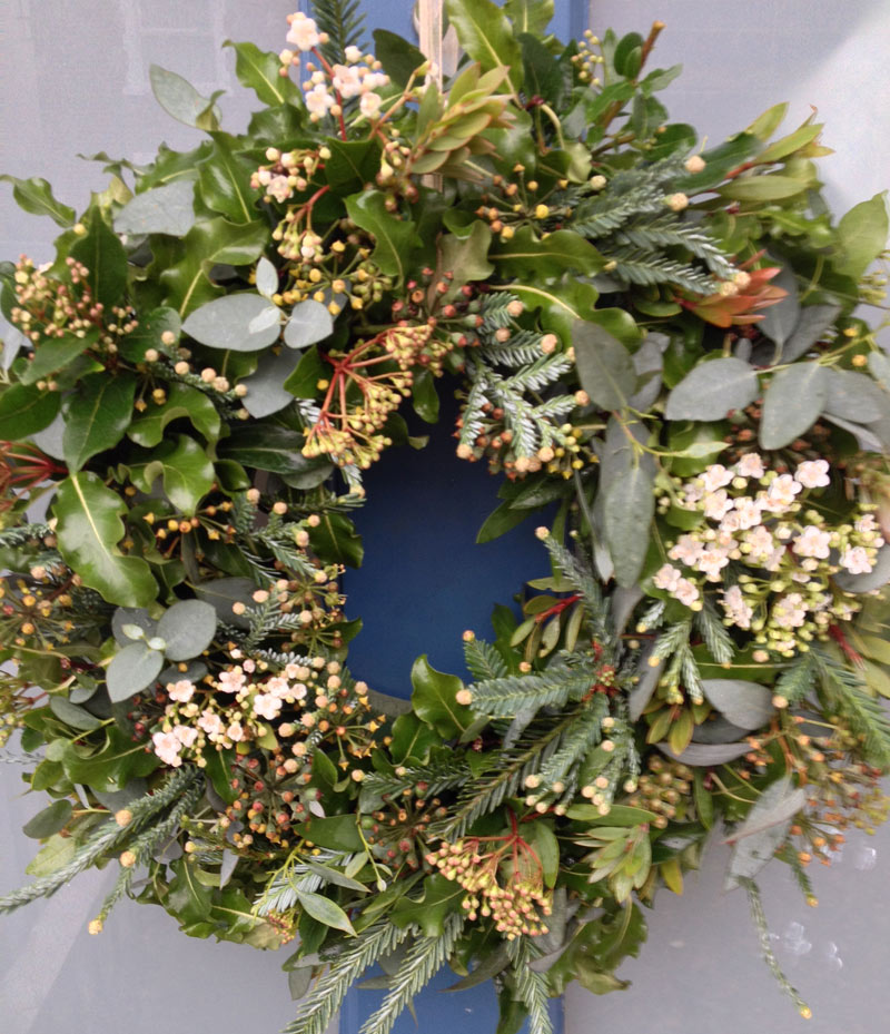 Christmas door wreath with Pitosporum, Eucalyptus, Viburnum tinus, ivy and fir