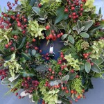 Christmas door wreath with rose hips, Hydrangea, Senecio, ivy and fir